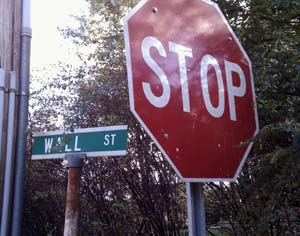 Stop sign next to sign for Wall Street, Cold Spring, NY