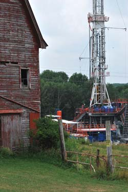 Drilling well next to barn