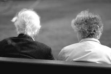 older couple on bench, seen from behind